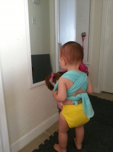 Checking herself out in the mirror. These generic diapers were actually some of my favorites.
